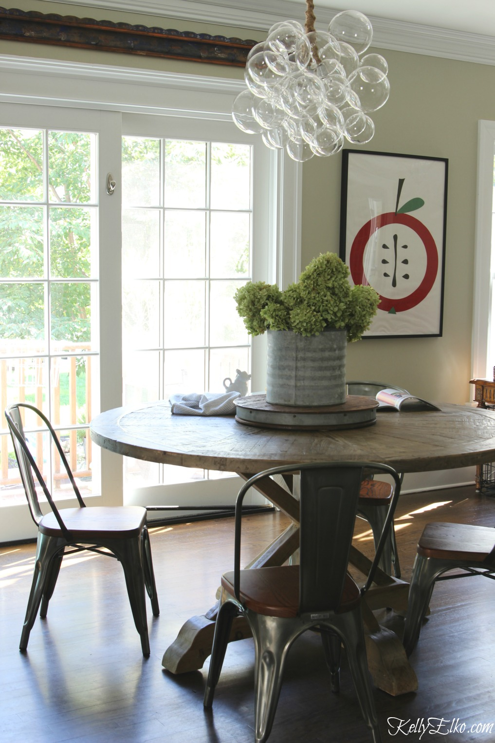 Wow - love the modern bubble chandelier paired with farmhouse kitchen table kellyelko.com
