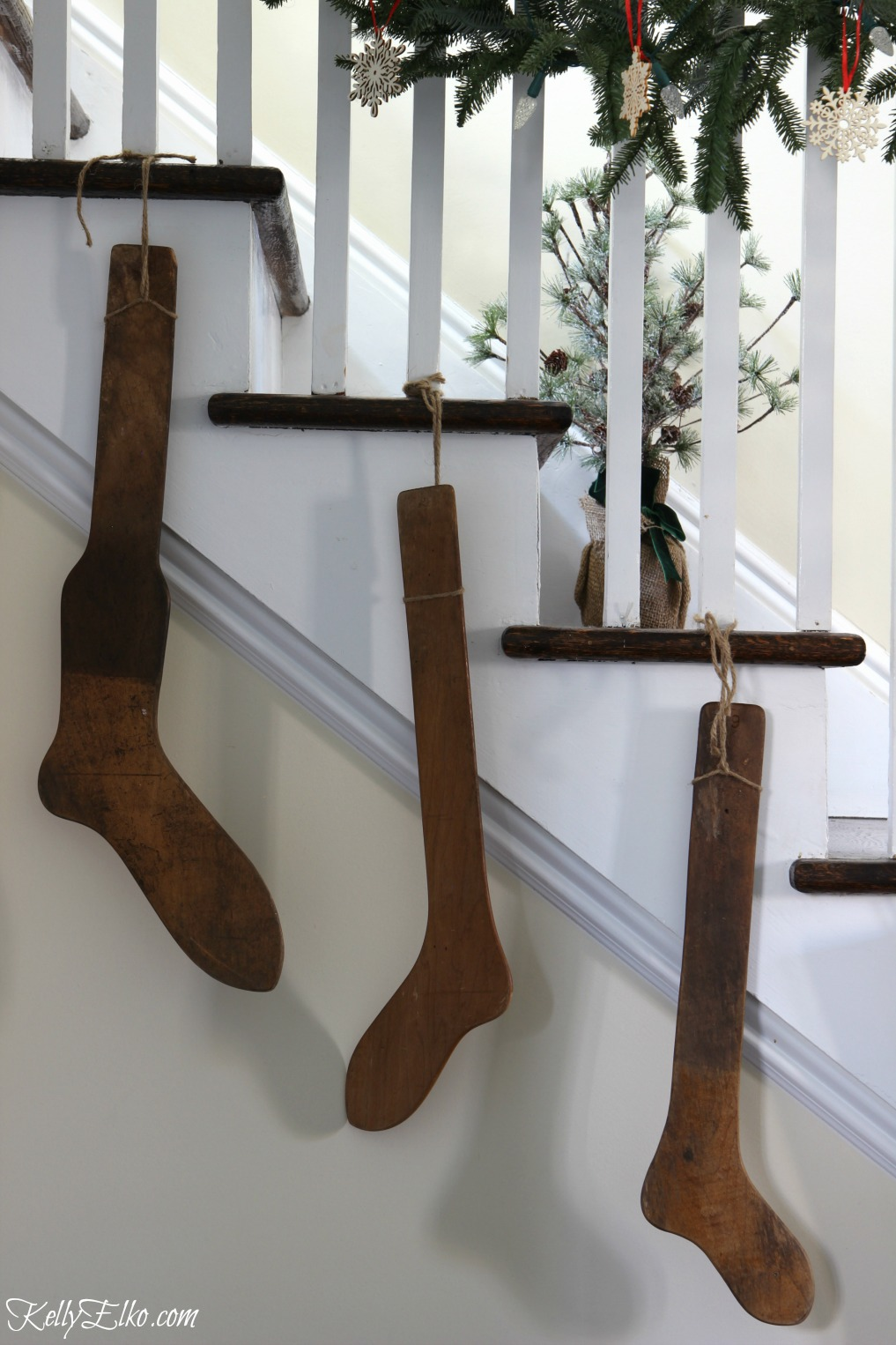 Antique stocking stretchers on the staircase kellyelko.com