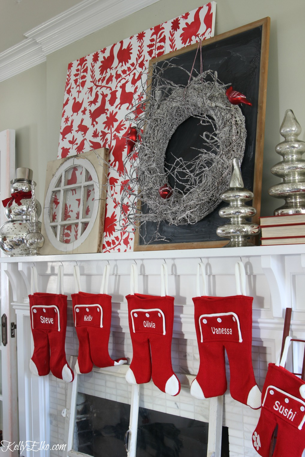 Love this festive Christmas mantel with otomi stencil, mercury glass snowmen and trees and the cutest long john stockings kellyelko.com