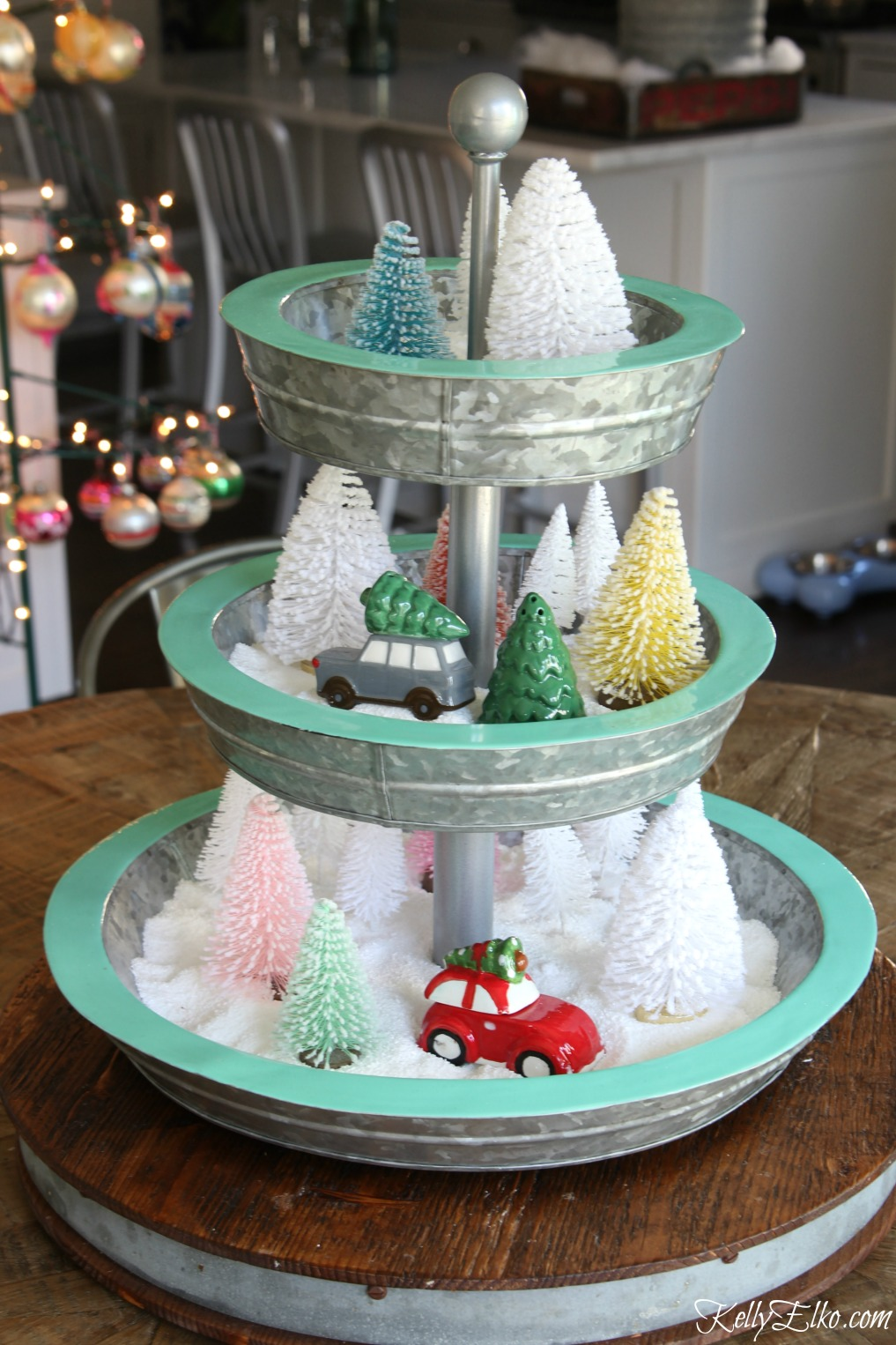 Love this tiered tray filled with bottle brush trees and snow kellyelko.com