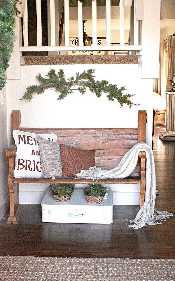 Love this little church pew in this farmhouse foyer