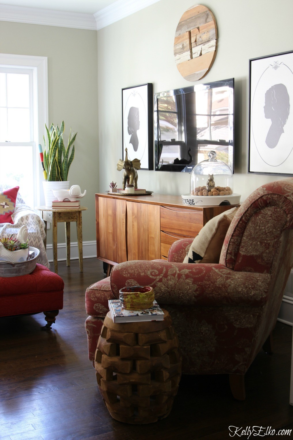 Love this cozy, eclectic family room with gorgeous mid century media console kellyelko.com