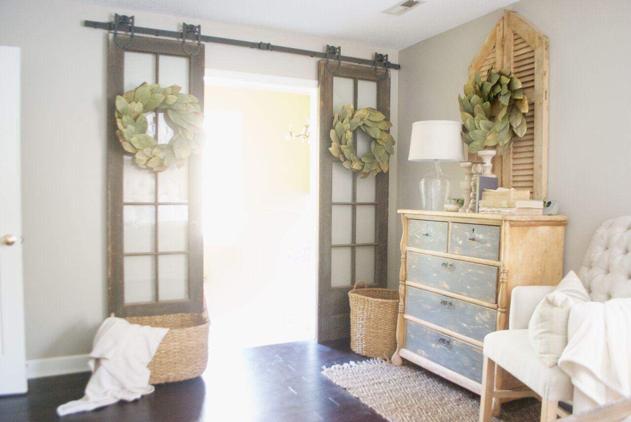 Double sliding barn doors with magnolia wreaths