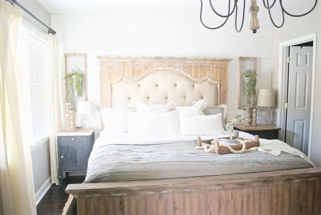 Neutral farmhouse bedroom with shiplap walls