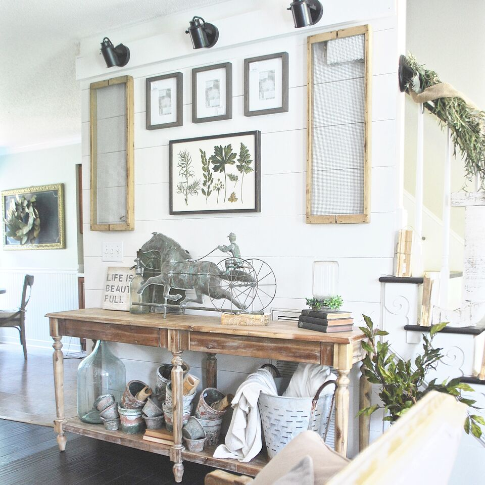 Love this farmhouse living room - the long console table and shiplap walls