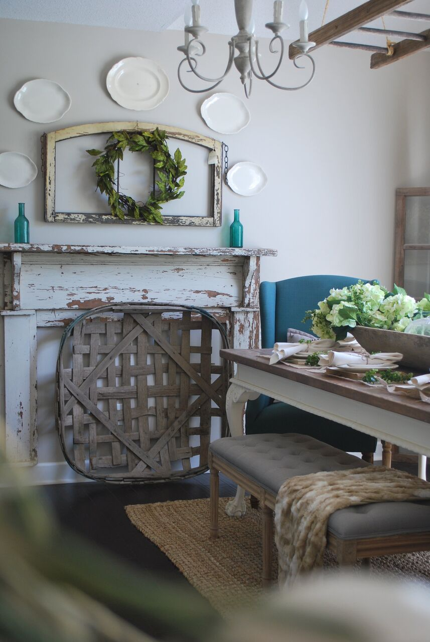 Farmhouse dining room with chippy old mantel and tobacco basket