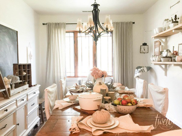 Farmhouse dining room with open shelves and giant chalkboard