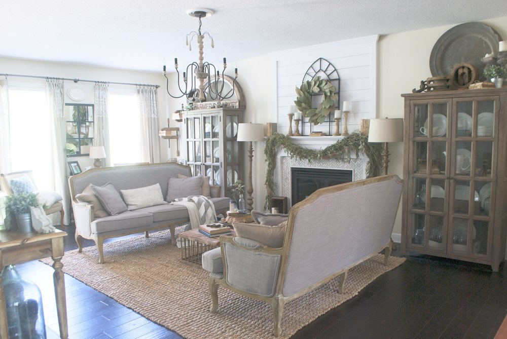 Farmhouse living room with double sofas and shiplap mantel