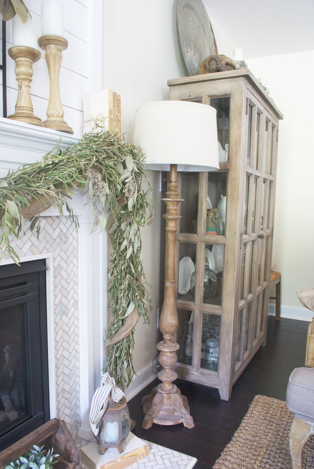 Farmhouse living room - love the herringbone tile on the fireplace