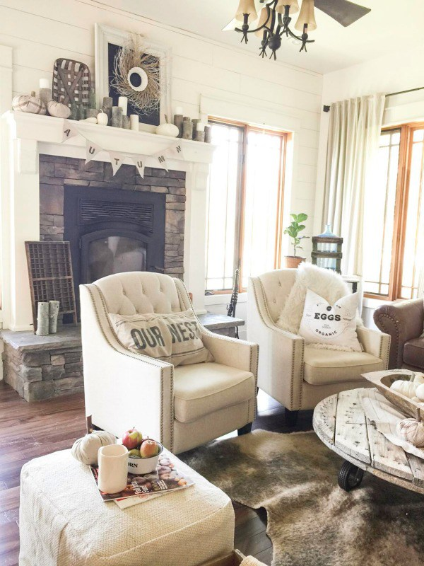 Love this farmhouse tour of Twelve on Main and the cozy living room with shiplap walls and stone fireplace