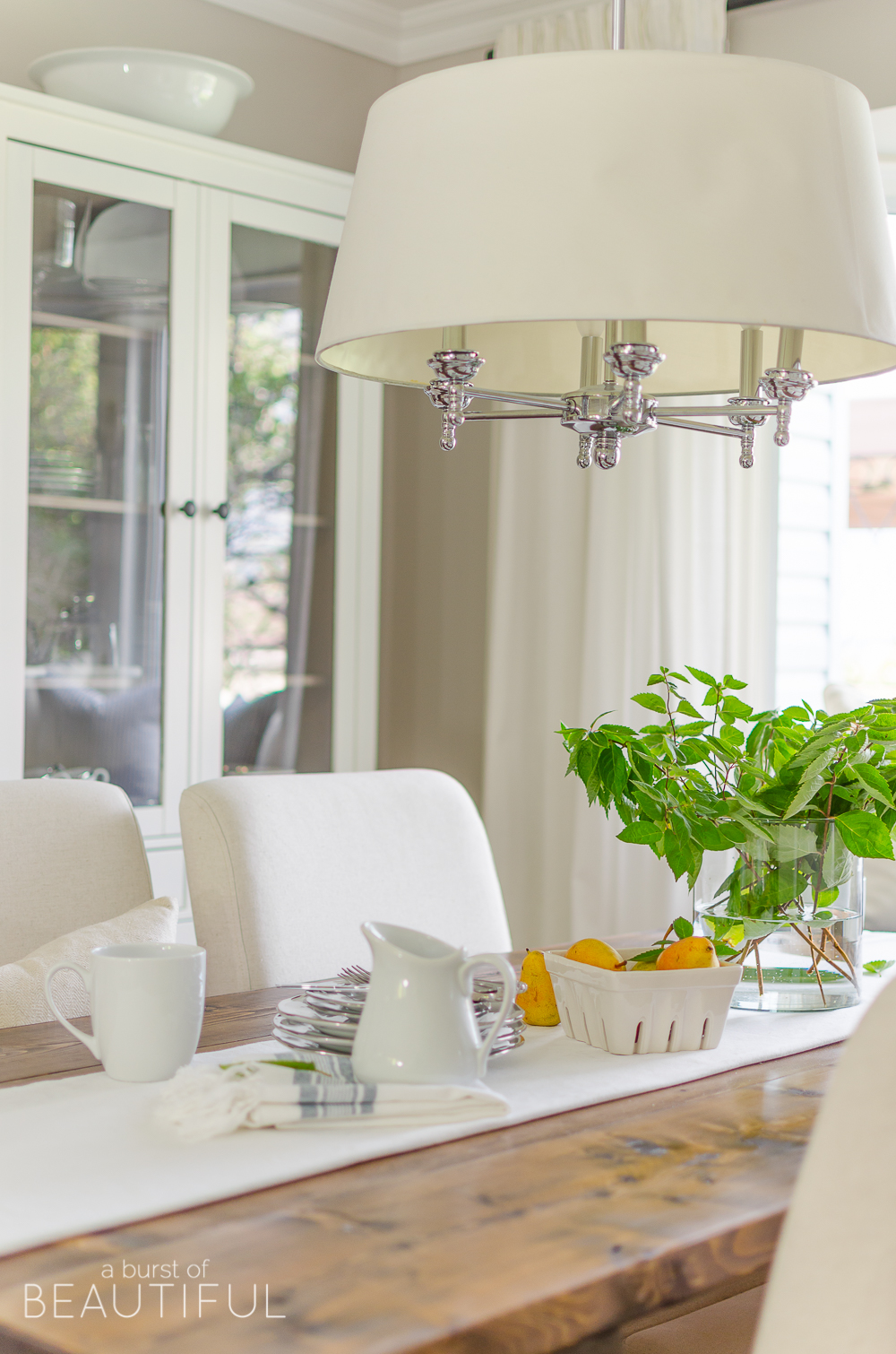 Farmhouse dining table with modern chandelier