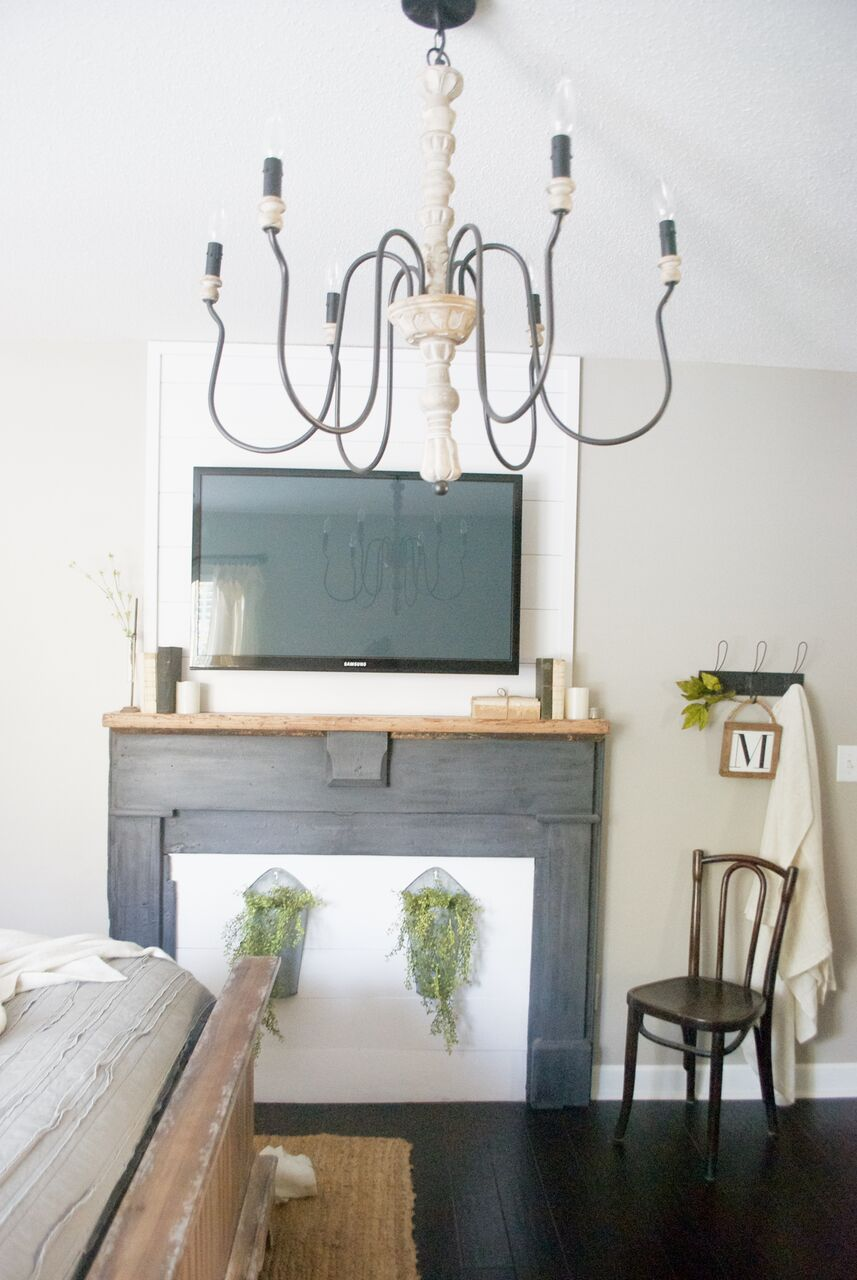 Love this faux mantel and ornate chandelier