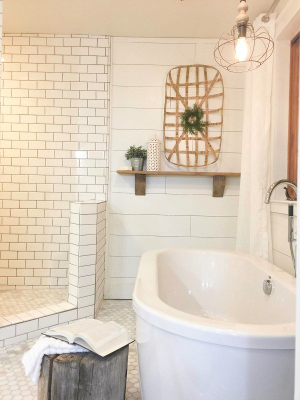 Love the modern freestanding bathtub and open shower with subway tile