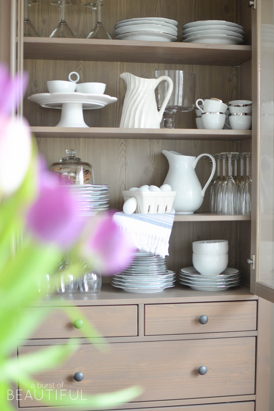 Love this hutch filled with white china