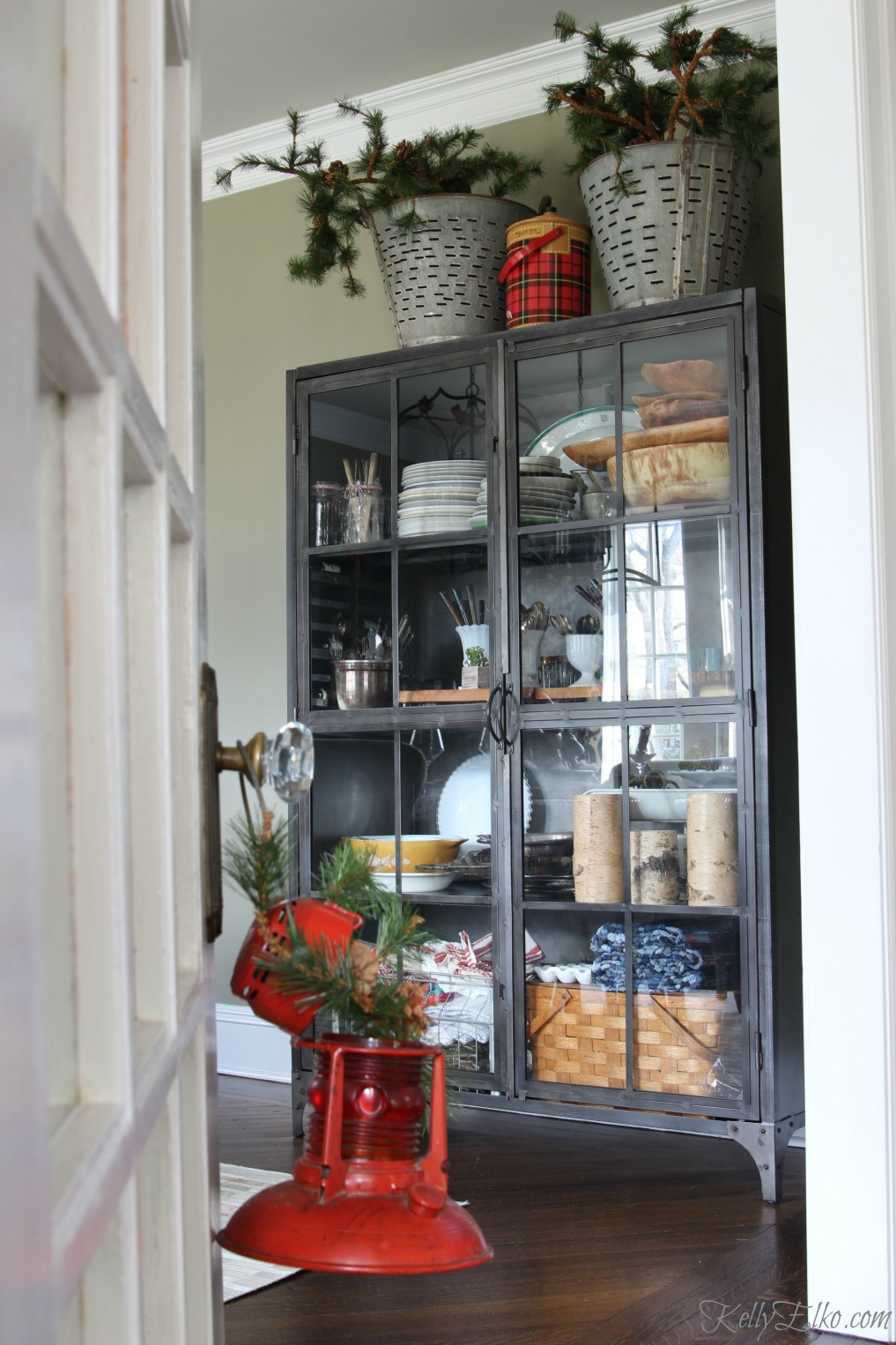 Love this industrial metal cabinet with glass for displaying favorites kellyelko.com