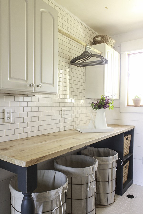 Laundry room with DIY butcher block counter and wall of subway tile