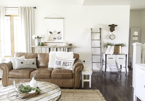 Cozy farmhouse family room with leather sofa