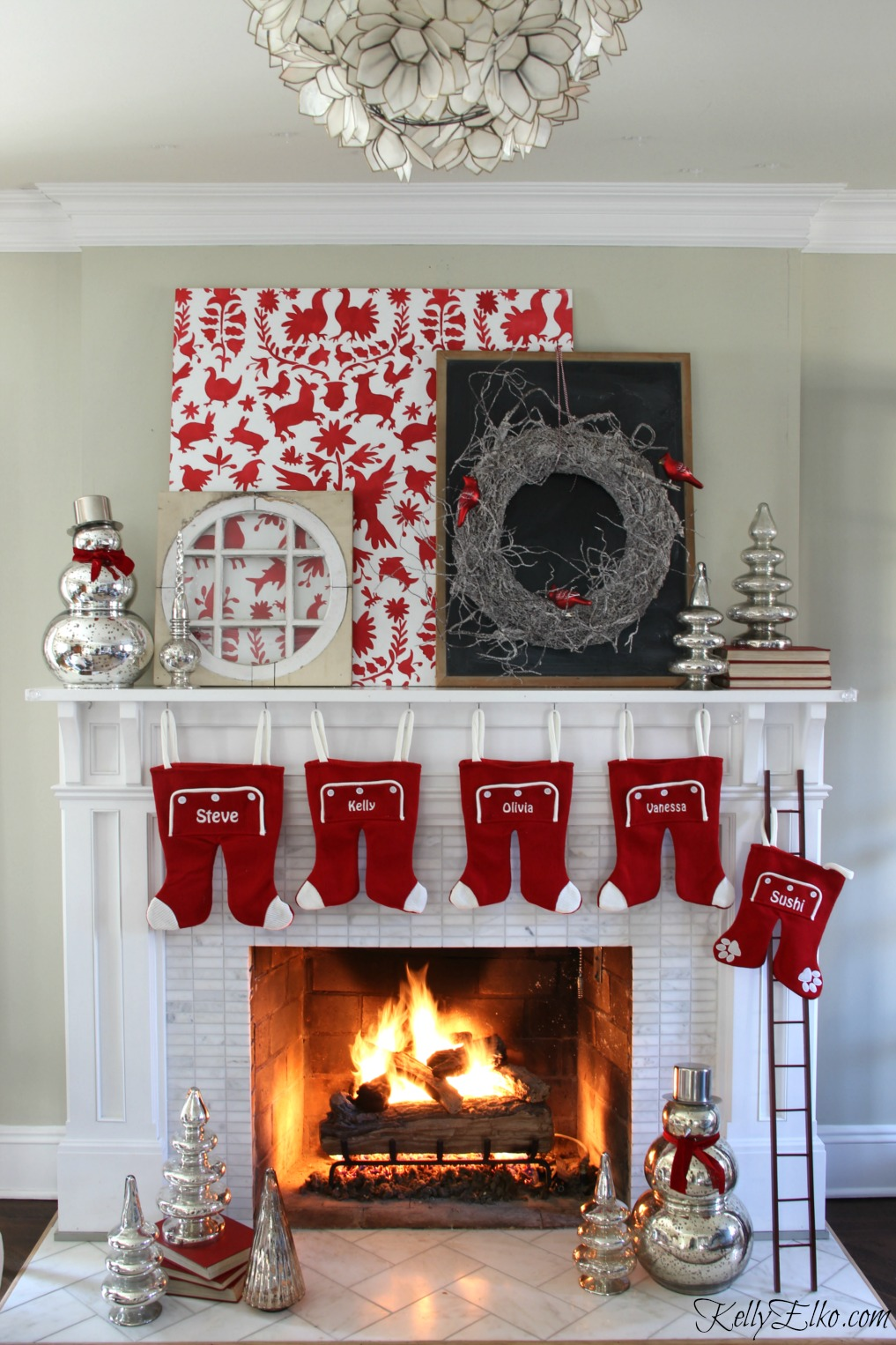 Love this otomi Christmas mantel and the mix of mercury glass and fun long john stockings kellyelko.com