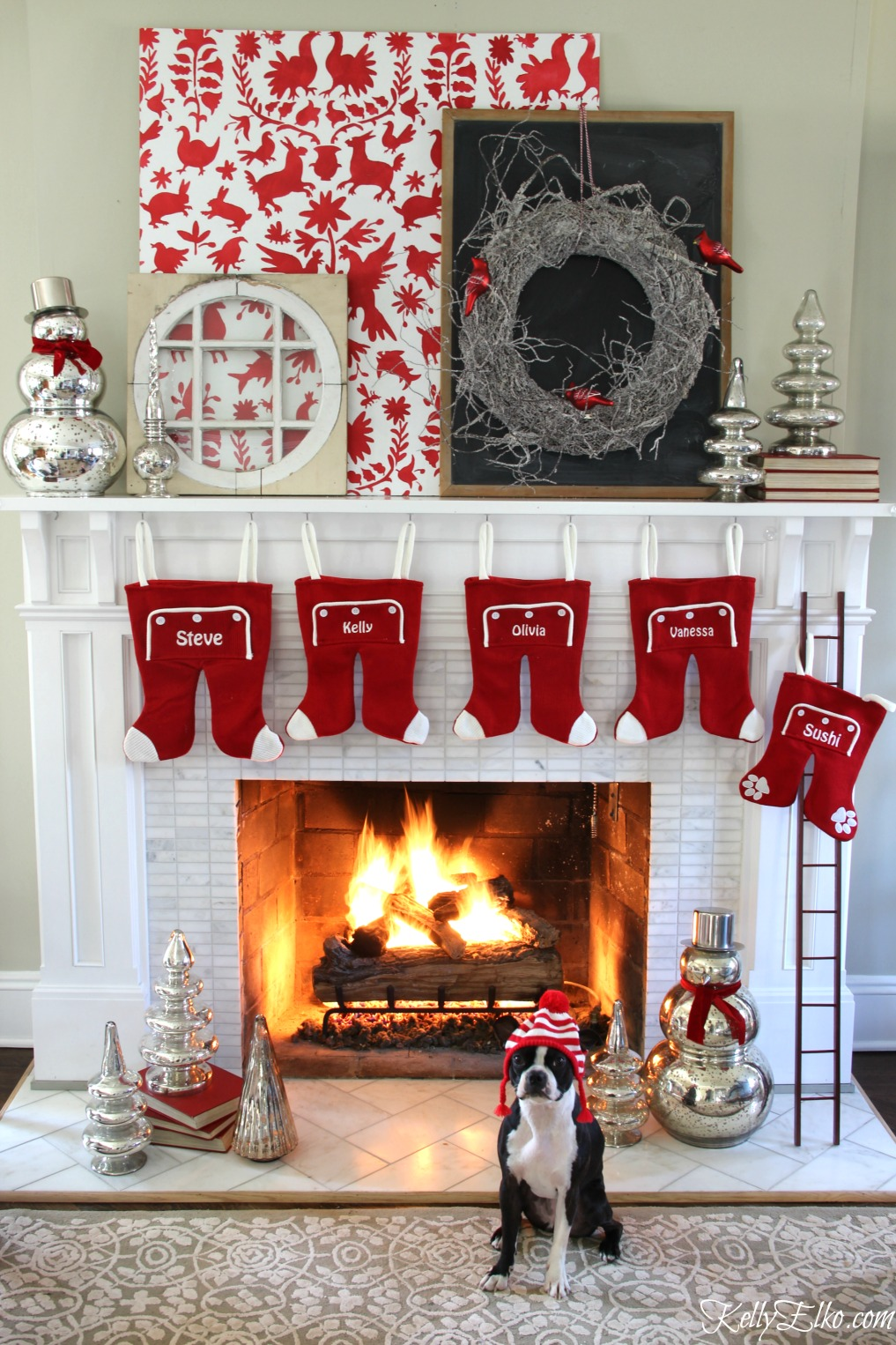 Love this unique Christmas mantel with otomi stencil and whimsical stockings kellyelko.com