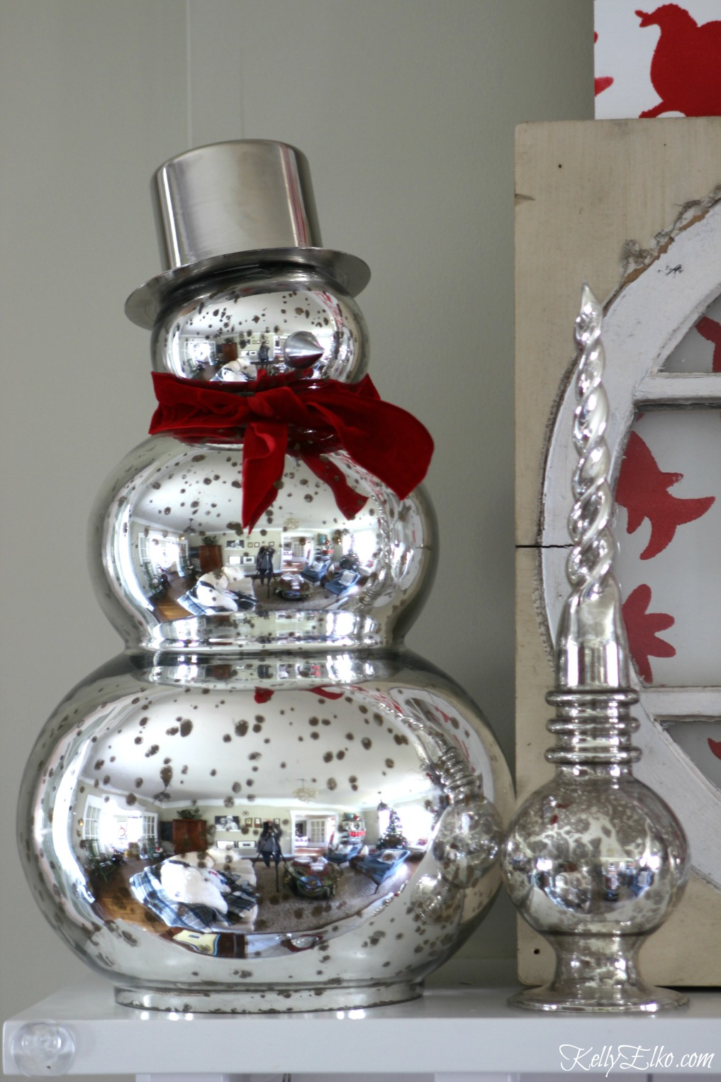 Mercury glass snowman on a festive Christmas mantel kellyelko.com