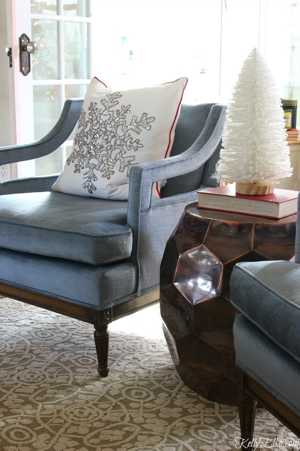 Love this blue velvet mid century club chair with festive snowflake pillow kellyelko.com