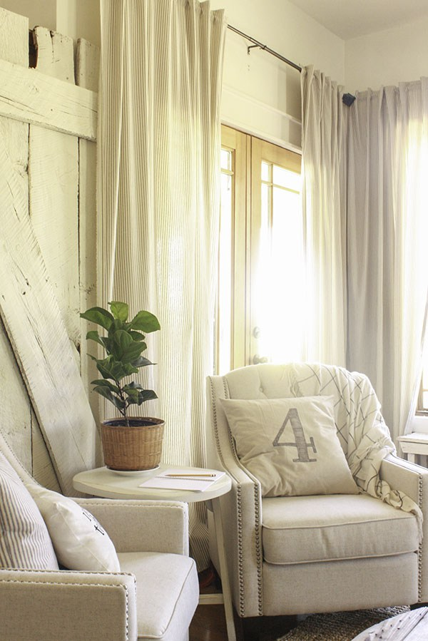 Love this cozy farmhouse family room with a pair of nailhead chairs