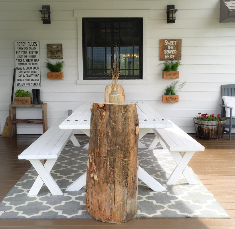 Rustic porch with DIY picnic table and wood log chairs