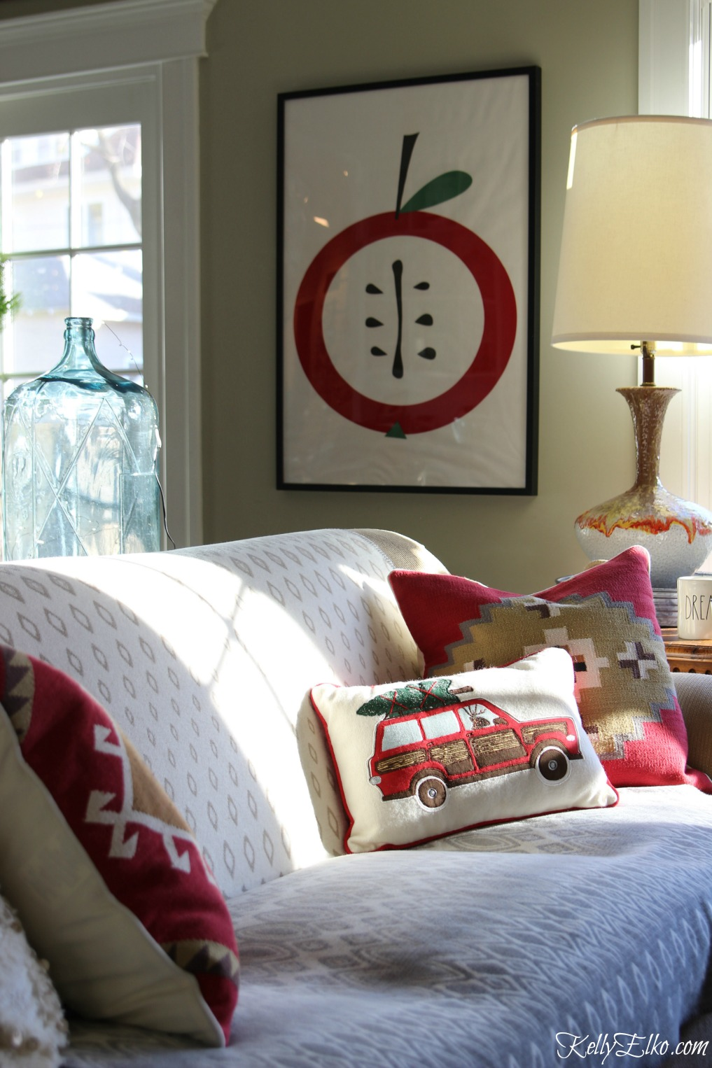 Cozy Christmas family room with red kilim pillows kellyelko.com
