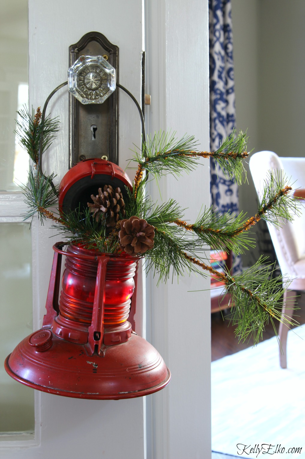 Vintage red lantern filled with Christmas greens kellyelko.com