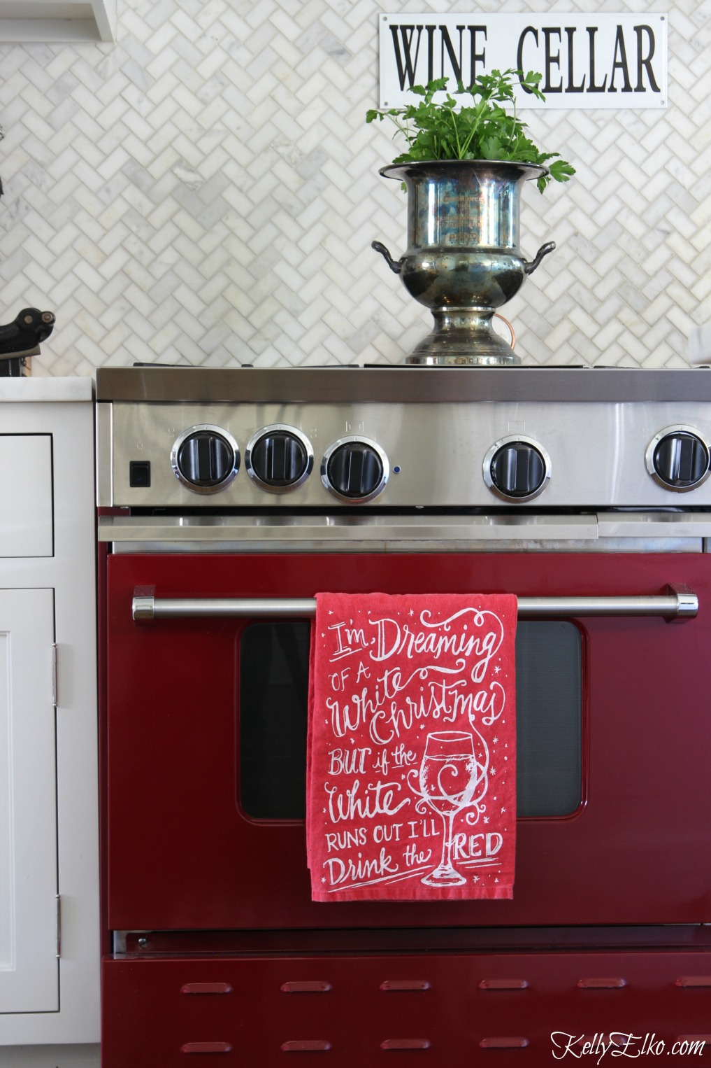 Love this red stove and white herringbone marble backsplash kellyelko.com