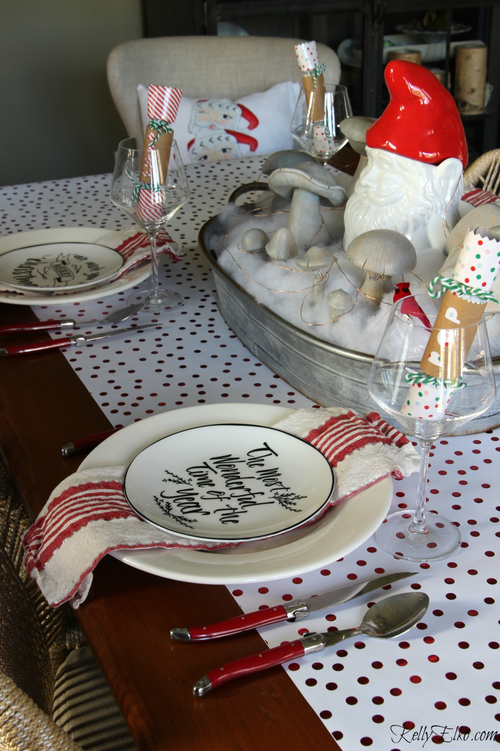 Love this festive red and white Christmas table with gnome centerpiece! kellyelko.com