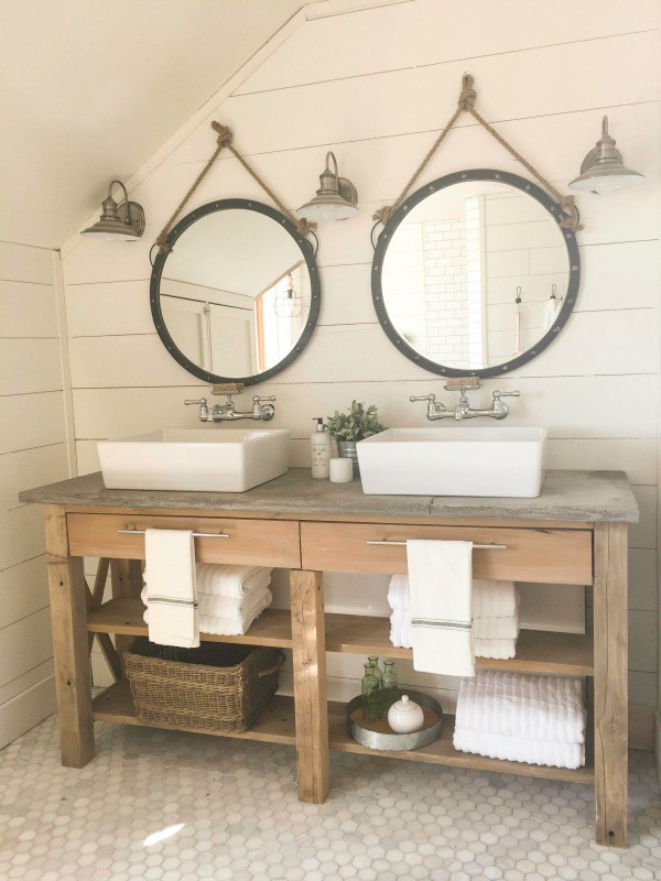 Rustic wood bathroom vanity with modern sinks and shiplap walls