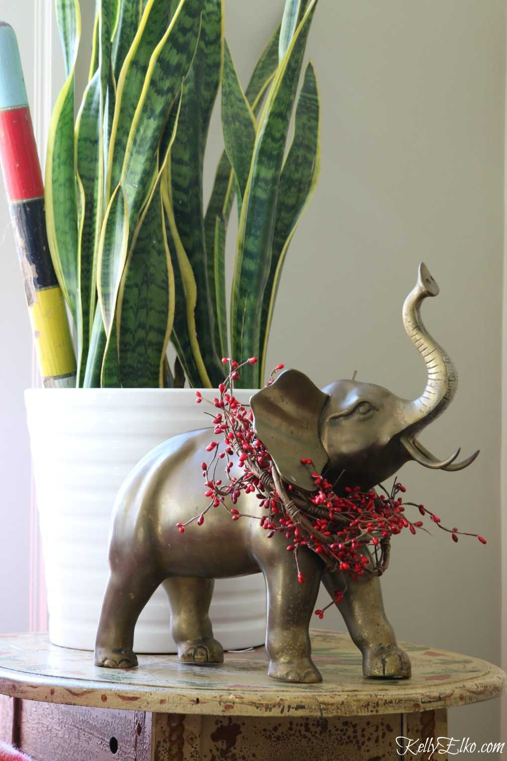 Vintage brass elephant gets a Christmas berry wreath kellyelko.com