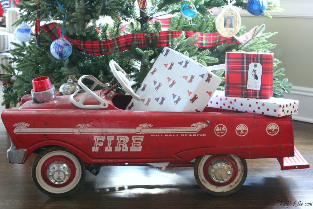 Vintage fire truck pedal car under the Christmas tree kellyelko.com
