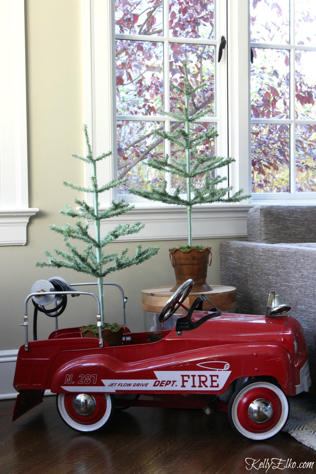 Vintage fire truck pedal car filled with feather trees