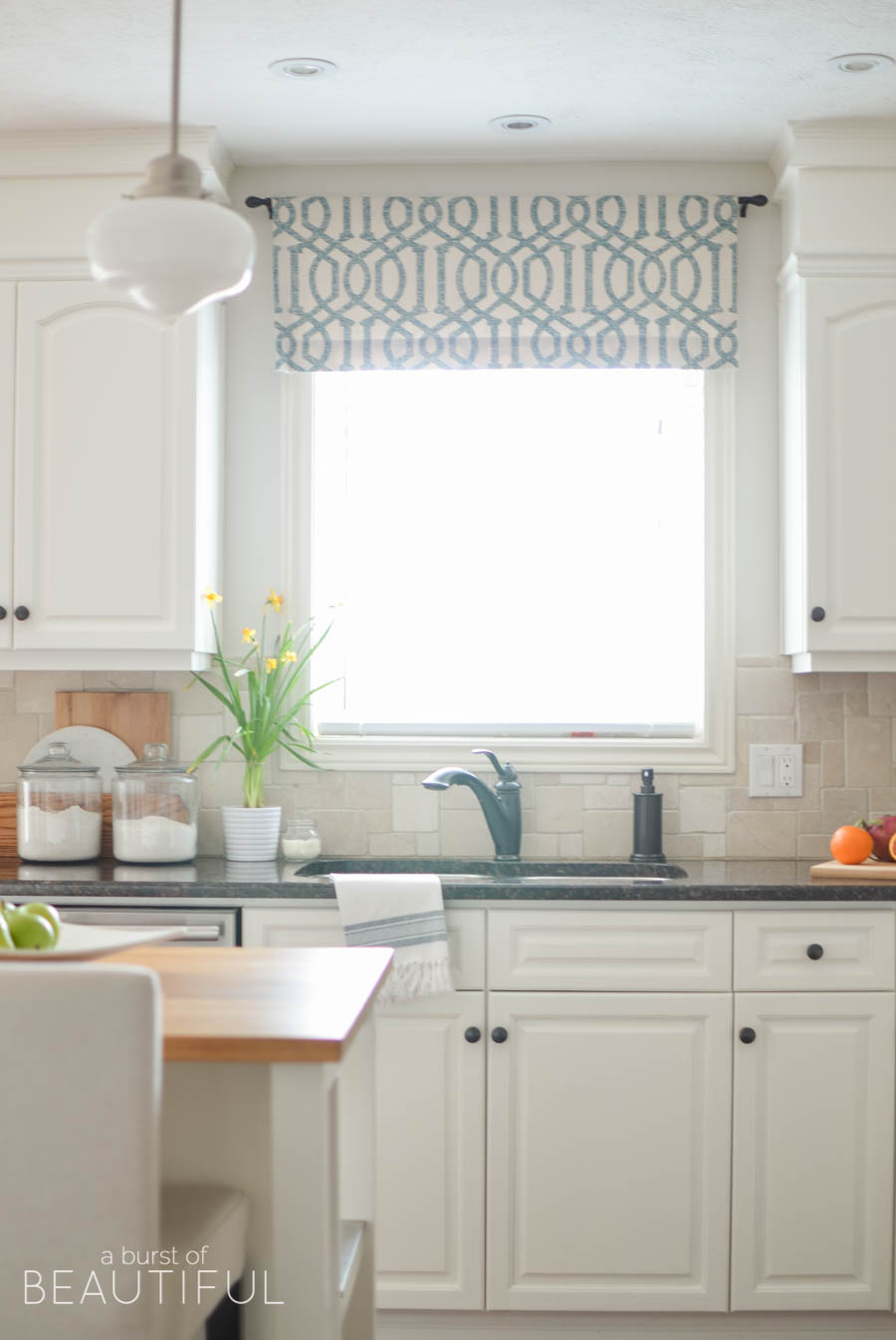 Farmhouse white kitchen with blue valance