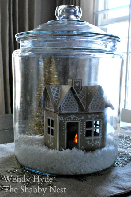 Paper mache gingerbread houses in jars