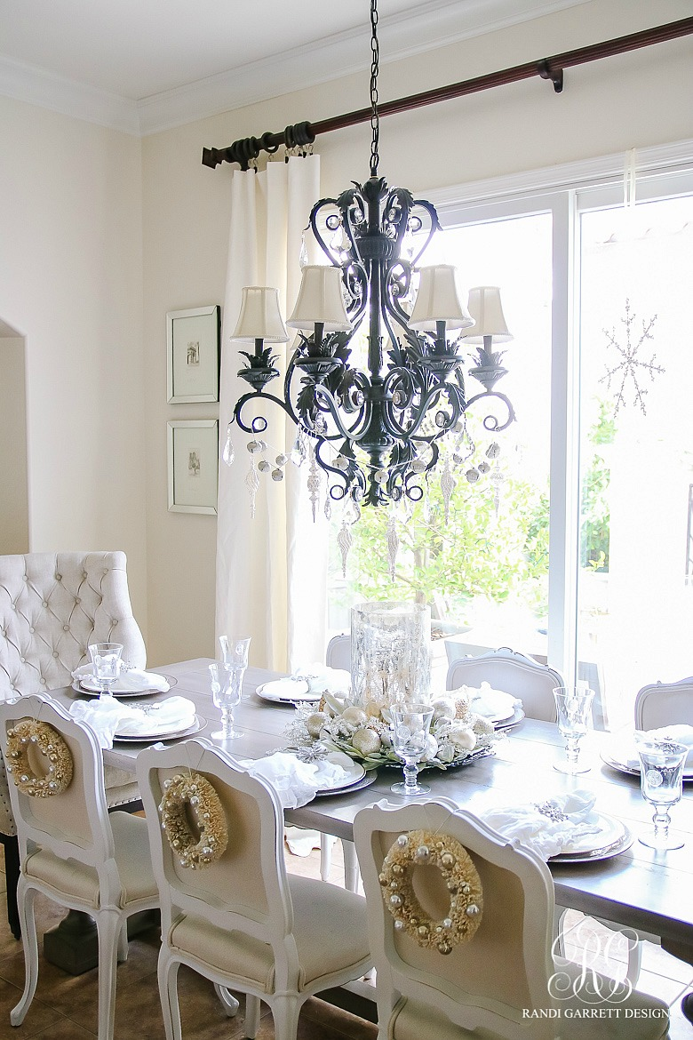 Add Christmas wreaths to the back of dining chairs for a festive touch
