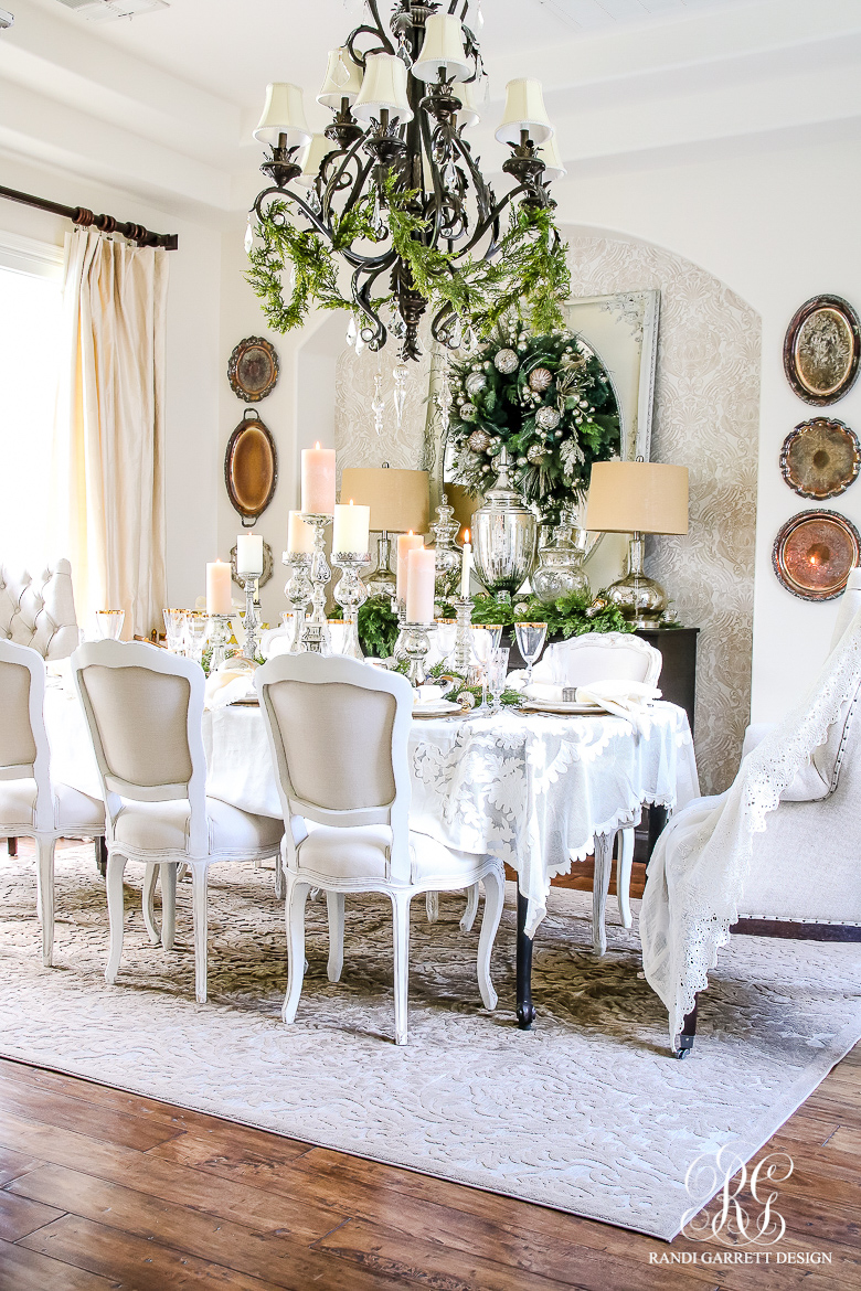 Christmas dining room - love the garland on the chandelier
