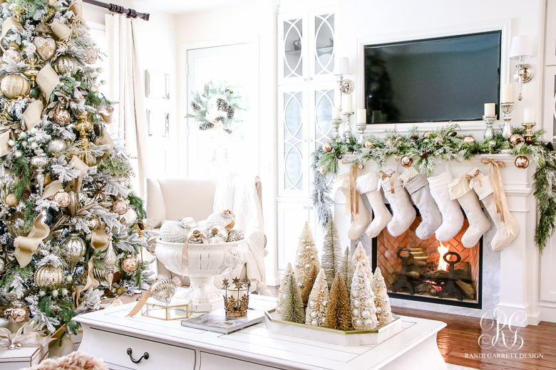Love this Christmas home in golds and whites and the row of stockings