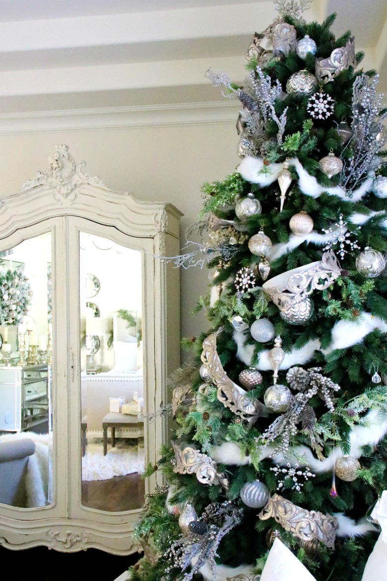 Beautiful bedroom Christmas tree - love the mirrored armoire