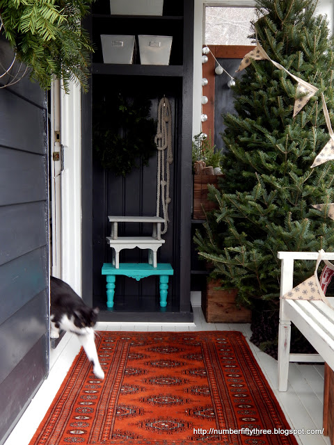 Christmas mudroom - love the almost bare tree