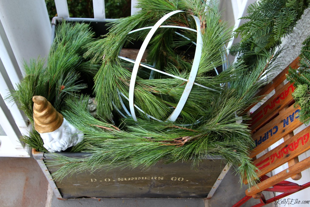 Christmas Porch - fill a planter with fresh garland kellyelko.com