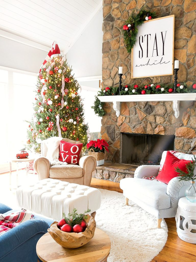 Christmas family room - love the giant Stay Awhile sign over the mantel