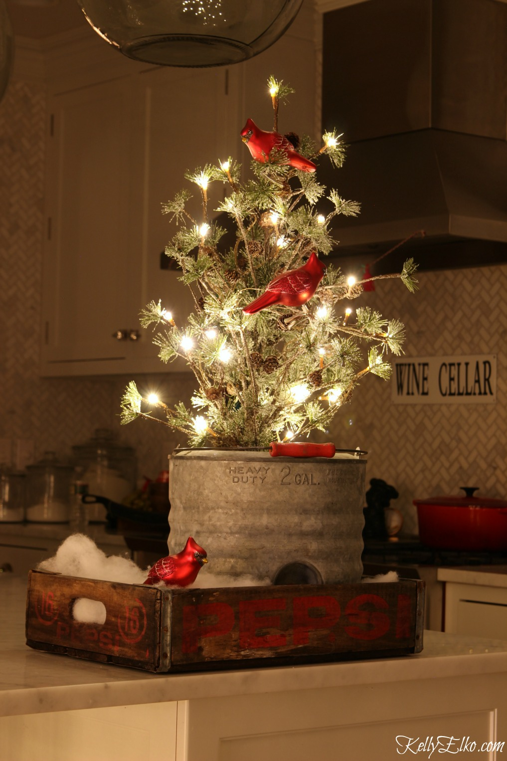 Christmas Lights at Night Home Tours - 35 homes by the glow of light - love this cute mini tree in vintage soda crate kellyelko.com