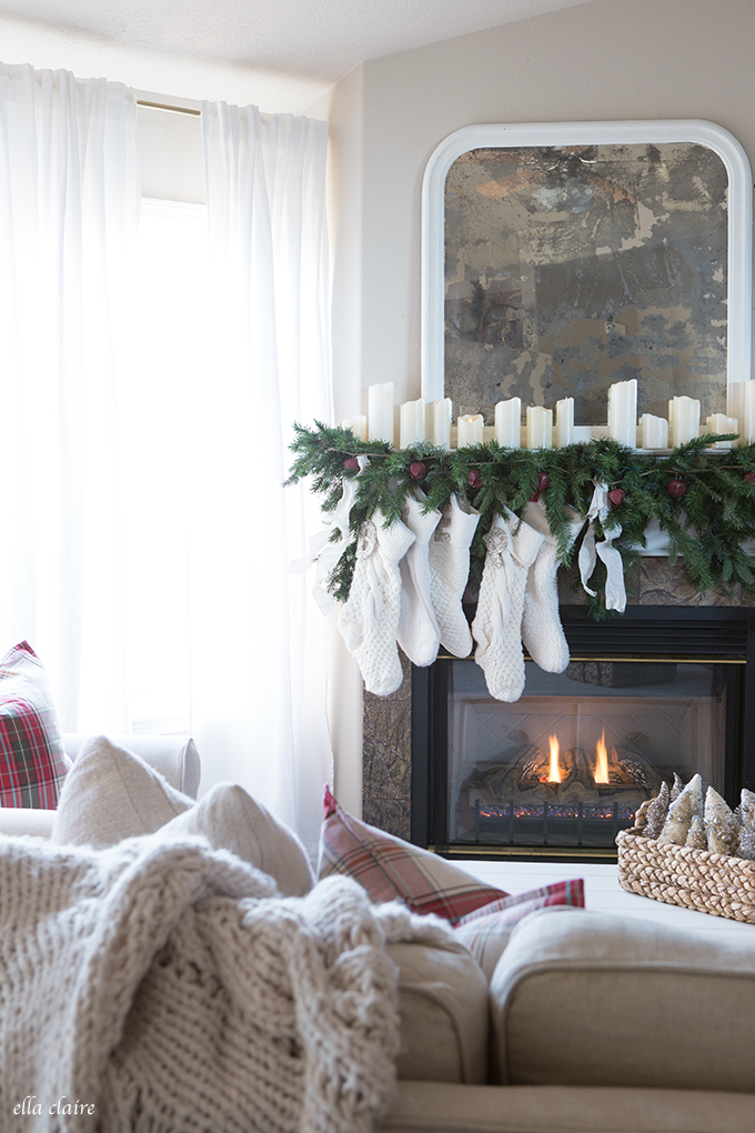 Simple Christmas mantel with garland and candles