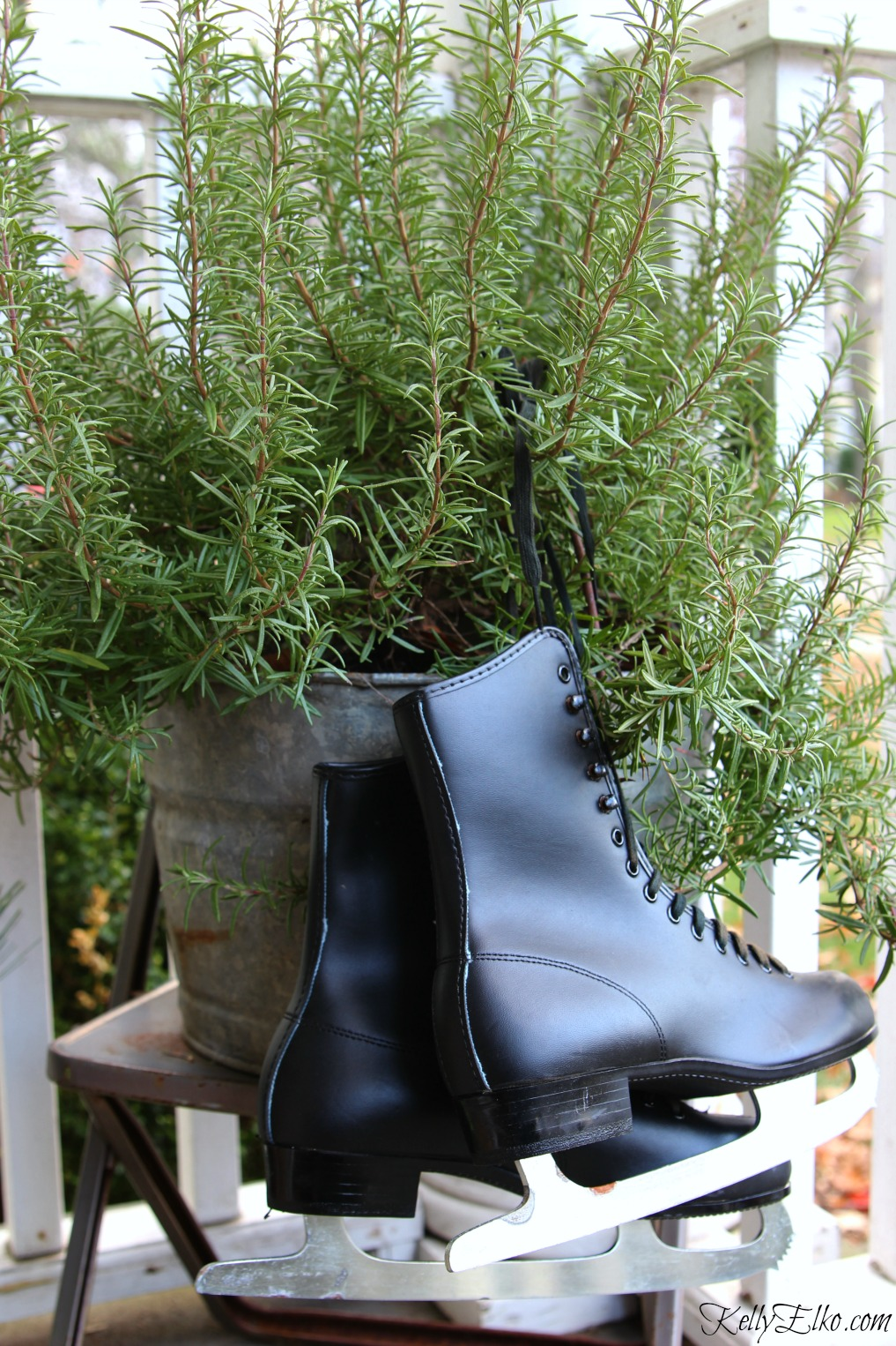 Tie an old pair of ice skates to a planter on this Christmas porch kellyelko.com