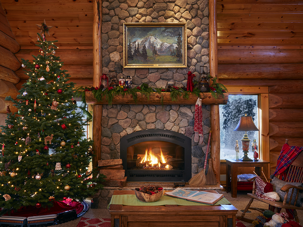 Love the stone fireplace in this beautiful log cabin kellyelko.com