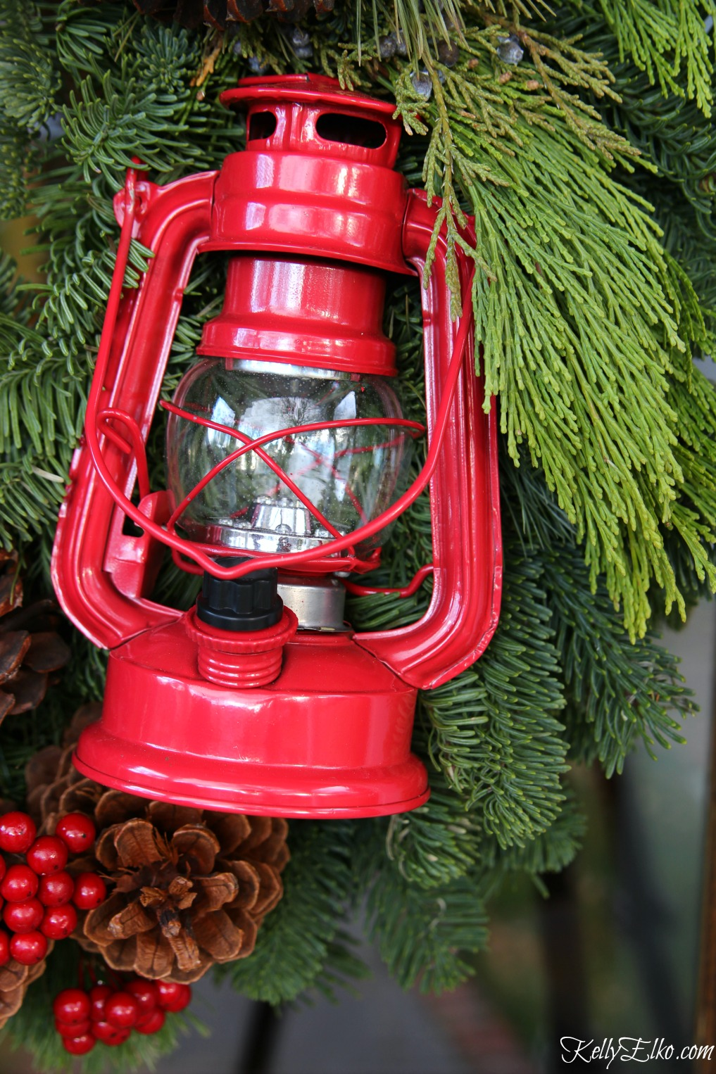 Cute little red lantern on a Christmas wreath kellyelko.com