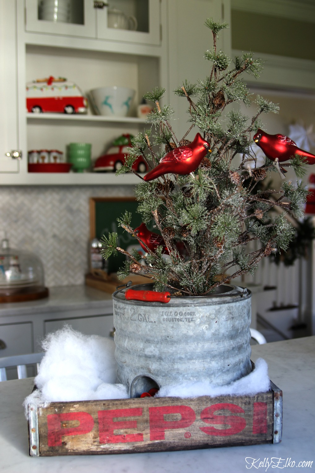 Vintage Pepsi crate makes a fun tray for Christmas and I love the old galvanized cooler with mini tree kellyelko.com